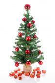 Christmas tree with red balls and gifts isolated at white — Stockfoto