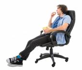 Lazy man sitting in armchair eating pop corn, isolated over white — Stockfoto