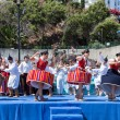 Dancers demonstrating a folk dance at the beach of Funchal, Madeira Island — Stock Photo #65474549
