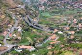 Aerial view of little villages and a highway in the mountains of Madeira Island — Stockfoto