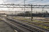 Railway tracks in morning sun at the Dutch station of The Hague — Stock Photo