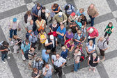Top view group of unknown tourists waiting at the old town square in the center of Prague, Czech Republic — Stock Photo