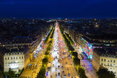 Streetview of famous Champs Elysees with illumination and traffic in Paris — Stock Photo