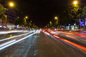 Evening streetview with illumination and traffic of Paris Champs Elysees — Stock Photo
