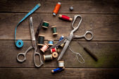 Vintage Background with sewing tools and colored tape. Sewing kit — Stock Photo