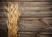 Wheat on wooden background — Stock Photo