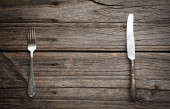 Knife and fork on wooden background. — Stock Photo