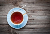 Cup of tea on a wooden background — Stock Photo
