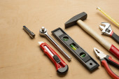 Set of tools on a wood panel — Stock Photo