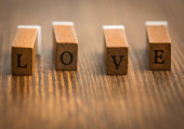 Love letters on wooden board — Stock Photo