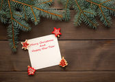 Christmas card on wooden with christmas decoration — Stockfoto