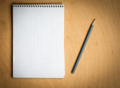 Notebook with pencile on a wooden — Stock Photo