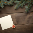 Christmas decoration. Blank scroll for text between fir twigs on dark — Stock Photo #57674923