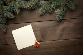 Christmas decoration. Blank scroll for text between fir twigs on dark — Stock Photo