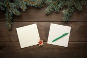 Christmas decoration on wooden background vintage paper christmas card — Stock Photo