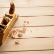 Carpenters plane on wooden background — Stock Photo #57772163