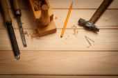 Carpenter tools in pine wood table — Stock Photo