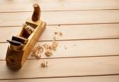 Carpenters plane on wooden background — Stock Photo