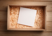 Empty wooden box with blank paper — Stock Photo