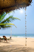 Untouched tropical beach with palms and fishing boats in Sri-Lanka — Stock Photo