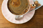 Cup of coffee on wooden table top view — Fotografia Stock