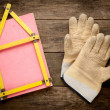 House concept with yellow meter and working gloves on wooden — Stock Photo #62133959