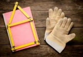 House concept with yellow meter and working gloves on wooden — Stok fotoğraf