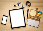 Digital tablet computer with isolated screen on old wooden desk. — Stock Photo
