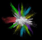 Colorful powder splash on black background — Stock Photo