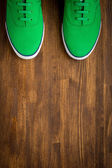 Outfit of traveler, student, teenager, young woman or guy. Colorful sneakers on wooden background. — Stock Photo