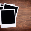 Blank photo frames on wooden background — Stock Photo #65887871