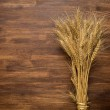 Wheat Ears on the Wooden Table. Sheaf of Wheat over Wooden. Harvest concept — 图库照片 #68249437