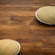 Concept with green sneakers laid on wooden floor. — Stock Photo #69065319