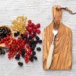 Tasty summer fruits on a wooden table. raspberries, Blackberries, mulberry, currant, red and yellow currant, — Stock Photo #76603125