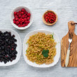 Tasty summer fruits on a wooden table. raspberries, Blackberries, mulberry, currant, red and yellow currant, — Stock Photo #76910749