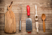 Rural kitchen utensils on vintage wood table from above - rustic background — Стоковое фото