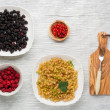 Tasty summer fruits on a wooden table. raspberries, mulberry, currant — Stock Photo #77044207