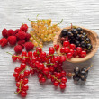 Tasty summer fruits on a wooden table. raspberries, mulberry, currant — Stock Photo #77044359