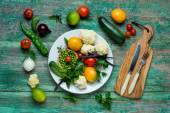 Fresh Organic Vegetables on a White Plate with Knife and Fork.   Vertical Composition — Stock Photo