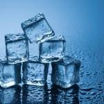 Wet ice cubes on blue background — Stock Photo #78977308