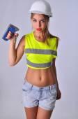 Sexy girl Builder stapler — Stock Photo
