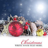Christmas background with red ornament and garland — Stock Photo