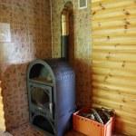Interior with wood burning stove — Stock Photo #56409547
