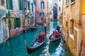 Gondoliers with tourists on gondolas — Stock Photo
