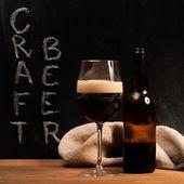 Dark craft beer id the glass — Stock Photo