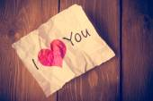 """Damaged card paper with the inscription """"I love You"""" - a symbol — Stock Photo"""