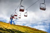 Ski lift mast in a summer mountain landscape at in the Alps — Stock Photo