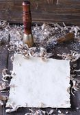 Carpenter tools with blank parchment. — 图库照片