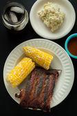 Barbecue Pork Spare Ribs with Corn and Potato Salad — Stock Photo