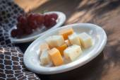 Cheese Plate with Red Seedless Grapes` — Stock Photo